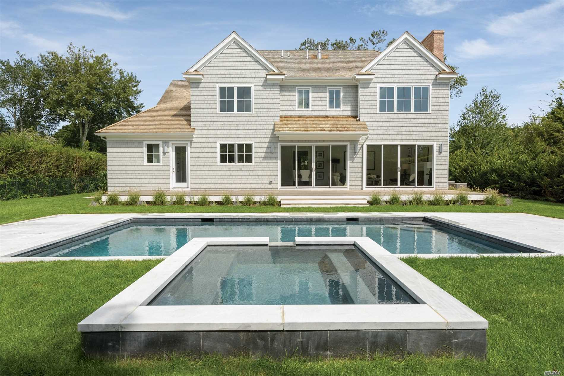 On Bucolic Red Creek Road In Hampton Bays, This Two-Story Postmodern Home On 3+/- Acres Has Five Bedrooms And Four Baths. It Borders Several Acres Of Protected Open Space, And Is Perfectly Planned For Entertaining Or Relaxing In Good Company, Indoors Or Out. The Driveway Opens Into A Parking Court With A Formal Fountain. The Columned Entrance Reveals A Light-Filled Open Living Space Brilliantly Illuminated By Huge Glass Doors, Large Windows And A Skylight. Enjoy The Heated Saltwater Pool Or Spa.