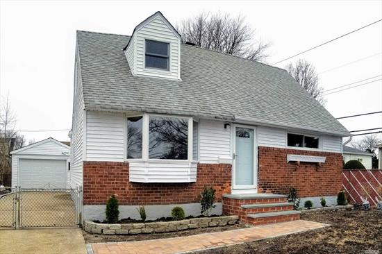 Freshly Renovated, Turnkey Home, In A Quite Neighborhood. Features 4 Bed & 1 Bath. Living Rm, Eik, New Kitchen Cabinets & Countertop, New Ss Appliances, Remodeled Bathroom. Gleaming Hardwood Floors, Led Downlights, Finished Basement W/ Utility/Laundry Room, 1.5 Car Garage, Cement Patio. Convenient To All, Shops & Lirr. Move-In Ready!