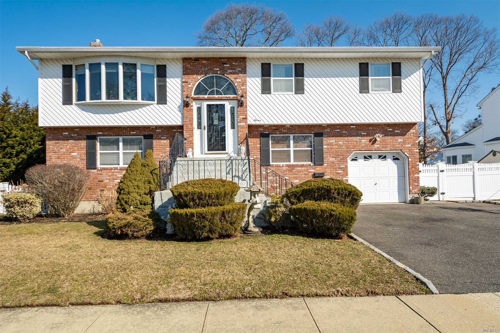 Tax grievence Reduction of $3908.reflected in taxes posted. Will begin in Oct/2019-2020 Near Village shopping, Railroad & Major Highways. Yet Nestled On Quiet Residential Block.Steps To/From Park Preserves. Beautiful Oversized Private Property ,  Turm Key. This Home Offers Spacious Bright Rooms.Hw Flrs.Lrge Lr W/Vaulted Ceilings Updated Kitchen & Baths. Cac. Updated Gas Heat. New Roof. 6 Zone Ugs Front & Back. Full Basement. Raised Paneled Doors.Mother/Daughter With Proper Permits. Must See!