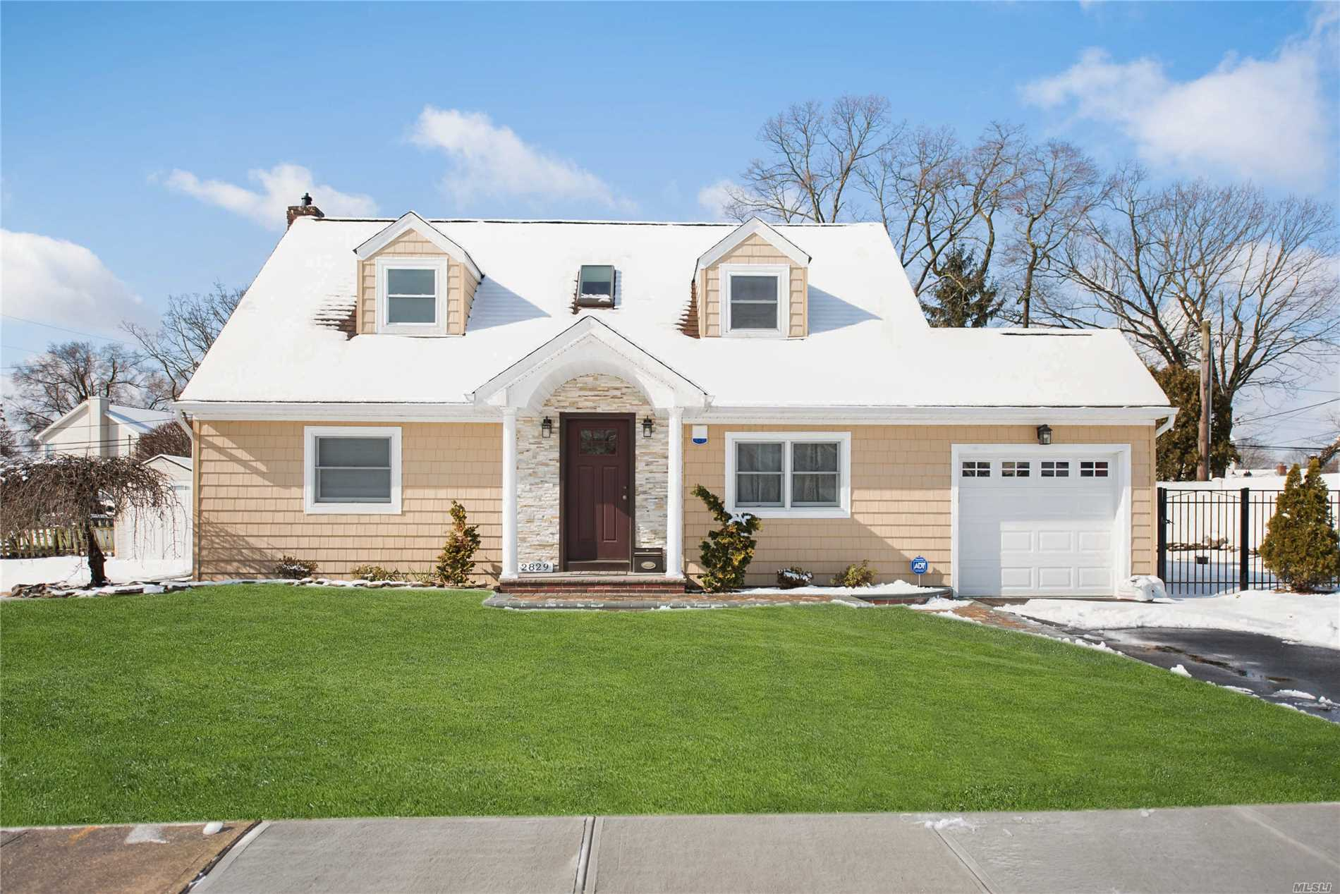 Many New Updates - New Roof/Siding/Fence/Portico/Concrete Patio/Garage Door/Tankless Burner/Most First Floor Windows Are New Andersons/Sliding Door. 4 Bedrooms, Master Bdrm On 1st Floor, Gleaming Hardwood Floors, Full Finished Basement With High Ceiling. Saw Mill Road Elem, Grand Avenue Ms, Mepham Hs. Close To Shopping And Parkways......