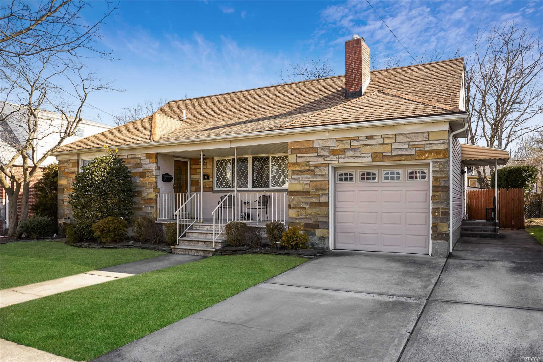 Unique, Deceptively Large Expanded Cape Located In Stewart Manor Village On An Oversized Property , Quiet Street. Ideal For A Large Or Extended Family. Finished Hardwood Floors Throughout, New Roof, New Bathrooms, & Gorgeous Eat-In Kitchen. Lovely Open Feel Throughout And Sliding Doors That Open To A Deck And Backyard. 2 Blocks From Newly Renovated Stewart Manor L.I.R.R. Station & Stewart Avenue Grade School. Total Taxes Include Village.