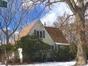 Expanded Cape Well Built Solid House, Oakfloors, Large Eik, Bdrm On 1st Floor, Living Room/Fireplace, Cathedral Ceilings On 2nd Floor W Bdrm, Bath, Full Basement W.Bath, Storage, Utilities, Large 2 Car Garage, , Close To All , Walk To Lirr, Shopping.