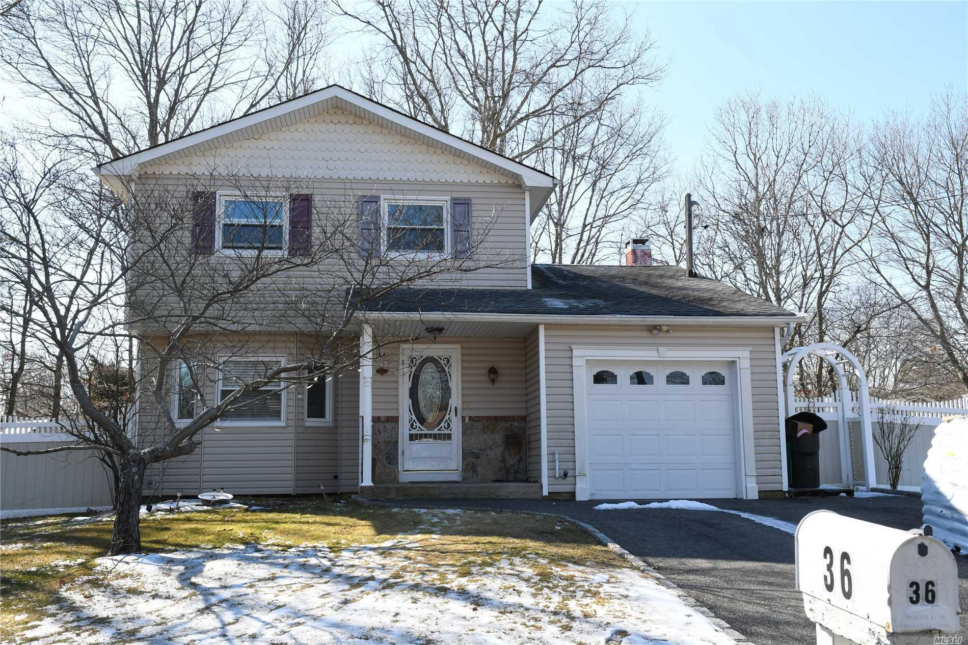 Welcome To This Mid Block Colonial Featuring New Siding, Windows, Hardwood Floors New Washer Dryer Full Bath Includes Soaking Tub.3 Bedrooms Den With A Half Bath. Beautiful Park Like Yard. Central Air 2 Zone Heat.