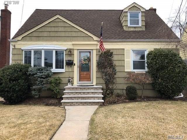 Mid Block, 4 Bedroom 1.5 Bath Cape Cod. Full Finished Basement With Outsie Entrance, Seperate Laundry Room, .5 Bath And Office And Den. 1 Car Garage. Updated Kitchen And Baths. Gas Heat. Attached Full Covered Porch.