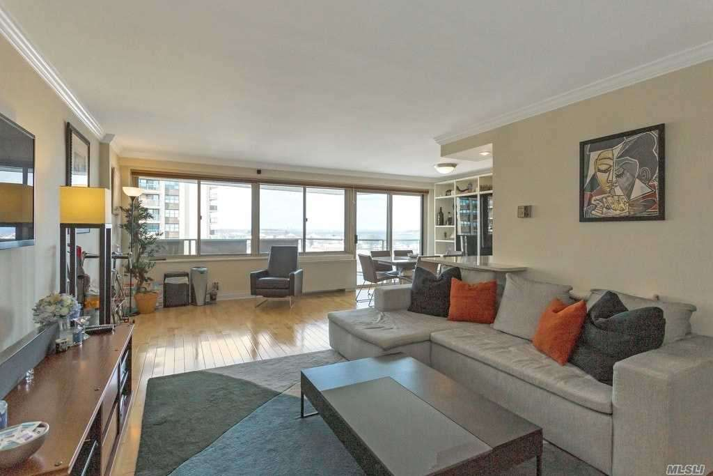 Rarely Available, DLX Bright Corner Apt W 2 Balconies, Enjoy Water Views From Every Room/Nyc Skyline, Southern & Northern Exposures, Abundant Natural Light, Spacious Living Room, Dining Room Alcove W Sliding Door To Balcony, Updated Kitchen W Gas Cooking/New Dishwshr, New Hardwood Floors Throughout, New Heat/Air Conditioning System In All Rooms With Own Control. En Suite Master Bedroom W Door To Balcony, Full Bath/New Shower Door, Great Closets, 2nd BR W Sweeping Water Views, Hallway, Full Bath.