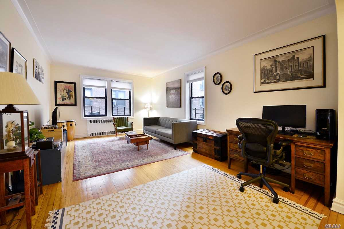 Gracious prewar apartment with 11 windows and three exposures. From entry hall there is a large foyer/dining area, then the spacious living room. To the left is a huge master bedroom, second bedroom and full bath with stall shower. The eat-in kitchen has been recently renovated with white cabinets, Ceaserstone counters and SS applicances. Small garden out back. 20% down. No subletting, Cat and small dog OK. Close to everything!