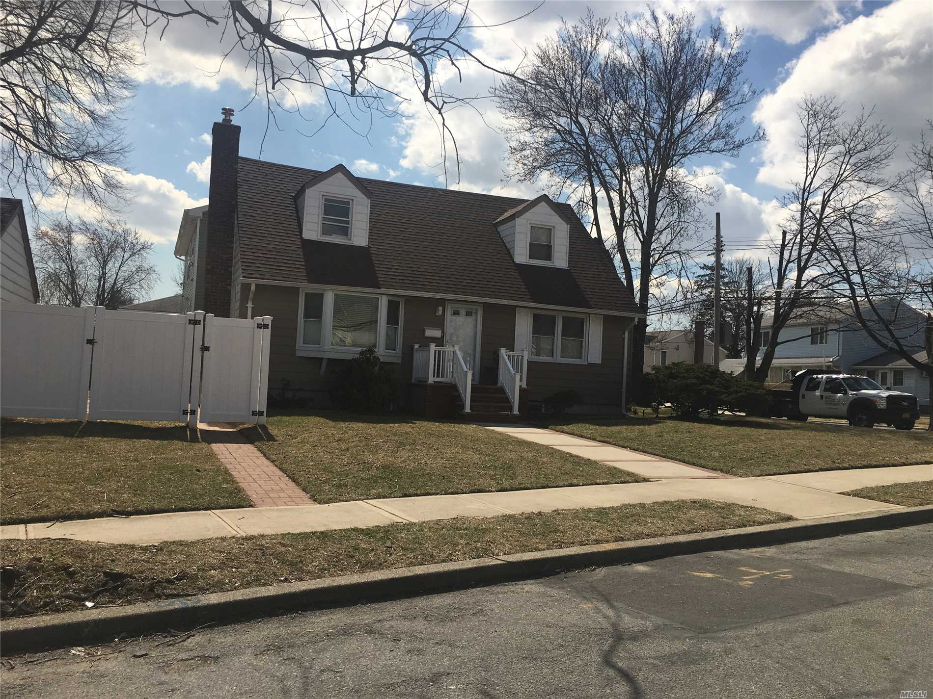 This stunning1 family home is on a large lot in Elmont NY. All bedrooms updated with connections, charming and comfortable home. 4Brs, Living room and 2.5 bathrooms, Kitchen, Det garage and much more. Updated throughout, good size for a family. From the open concept kitchen and living space to the large shaded backyard, Great also for Investment.