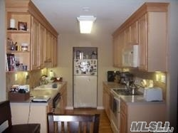 NorthSide of Development. Close to pool, tennis, clubhouse, gated at night. Spacious 2 Bedroom. Update kitchen. Private location lower level unit. Spacious! Board Approval required. NO pets as per Nob hill requirements. Close to all. Shopping and LIE and Long Island Railroad