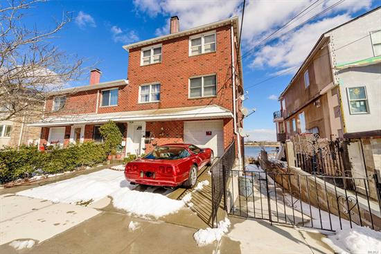 Rare opportunity!!!! ALL BRICK WATERFRONT 2FAM with a full finished basement which has separate rear walk in entrance. Very well maintained by the tenants this house also includes an ATT garage, hardwood floors, fireplace on all 4 levels and multimillion dollar water and bridge views from the backyard and LR windows. House is NOT located in flood zone