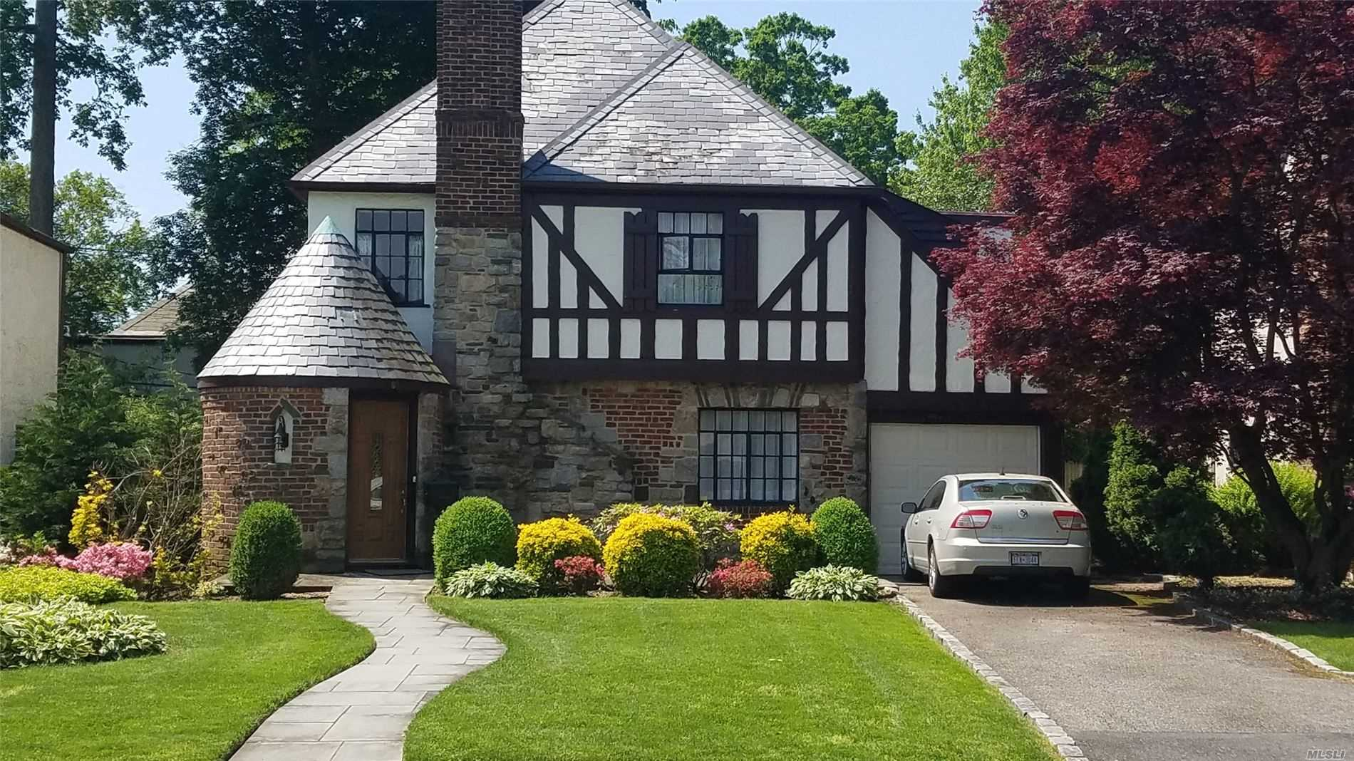 Picturesque and charming Tudor on a quiet street one block away from the country club/golf course. Hardwood floor throughout main level. Beautiful large living room with fireplace. Formal dining room with chandelier. Eat in kitchen with granite countertops and a full pantry. Large master bedroom with full bath. Three more bedrooms and full bath with both bathtub and shower. 40 mins from Penn Station.