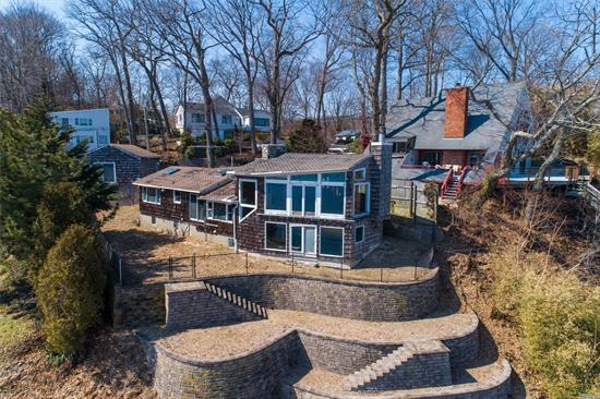 Unfinished Symphony!! Rare opportunity to purchase Waterfront Parcel with 62+ ft. of Protected Harbor waterfront property. Sea wall with elevated land. Vista Views! Current building can be demolished or salvaged. Get your own architect for your own vision. Deeded with Private Beach Asso. boat ramp, mooring, dock, pavilion. Year round or weekend waterfront living!!