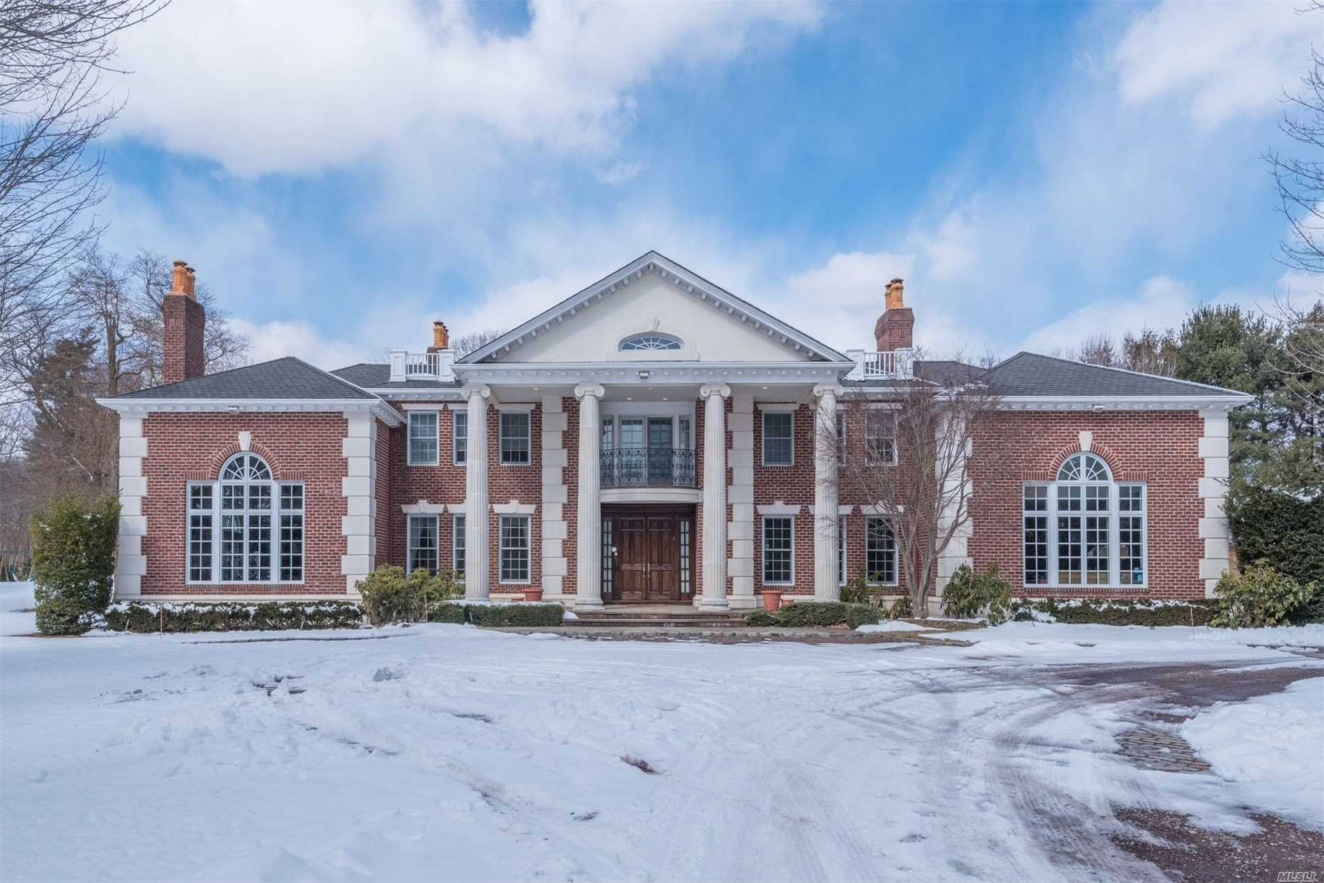 Old Westbury. Mint 9000 Square Foot Center Hall Georgian Colonial overlooking the Polo Fields of Old Westbury. Dramatic 2 Story Entry Foyer. Great Home For Entertaining With 12' High Ceilings, Bright Sunlit Large Rooms & Beautiful Millwork Throughout. Oversized Master Suite With Sitting Room & Large His & Her Walk In Closets. Lower Level Offers 15 Seat Theater, Gym, Large Playroom And Plenty Of Storage. Gunite Pool w Jacuzzi as well as your own 150 Yard Golf Hole. Gas Generator. A Must See!