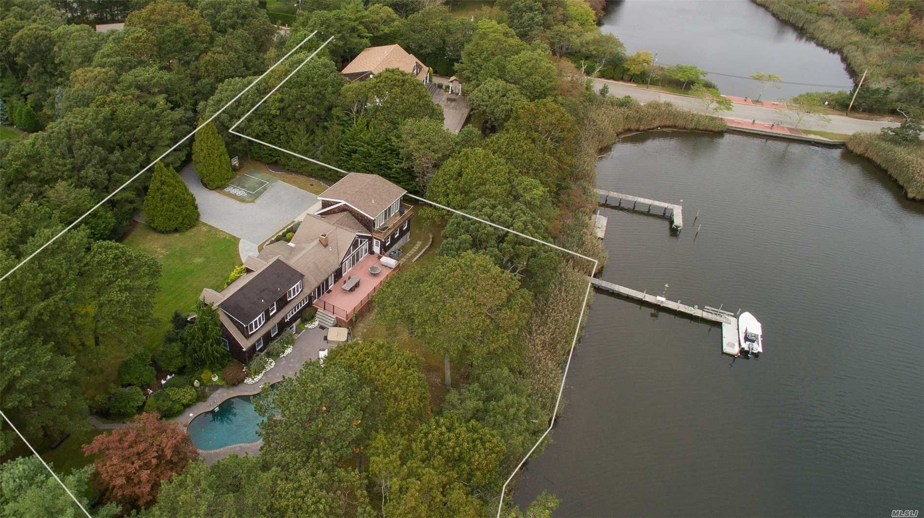 Spectacular Waterfront Location Not To Be Missed. This 3200 Sq.Ft Home Boasts Breathtaking Views W/Large Living/Dining Space Ideal For Entertaining. Home Offers Private Master Suite/Bath. 4 Bedrooms, Kitchen And Finished Basement. The Beautifully Landscaped Grounds Provides Ultimate Privacy W/Htd Gunite Pool, Hot Tub And Private Dock. A Boater's Dream! Walking Distance To Town. A Must See!