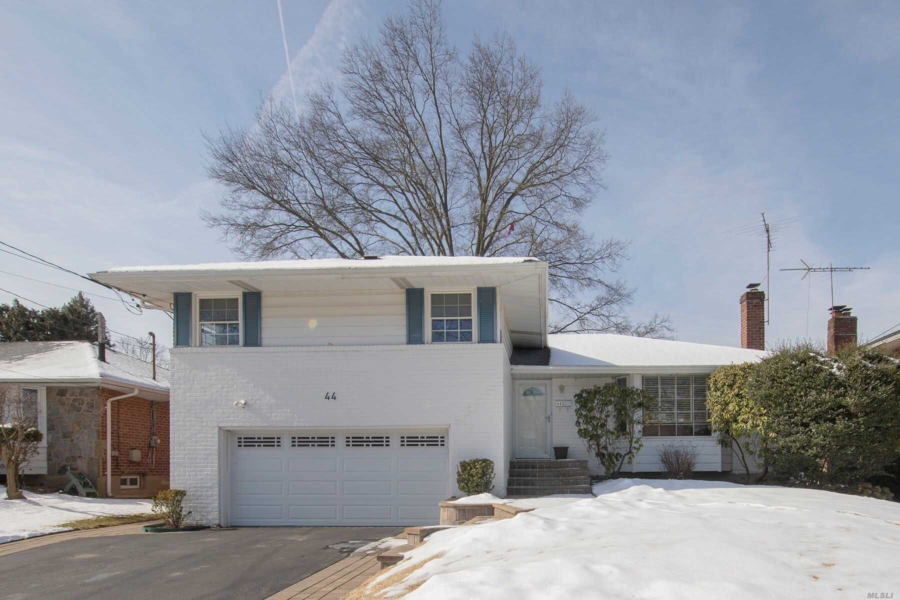 Welcome To The Prestigious Westbury Hills Section of Westbury. This Beautifully Maintained Split Level Home Boasts 3 Bedrooms and 2 1/2 Baths. Hardwood Floors And Updates Throughout! Perfectly Situated Mid Block In This Very Charming Quiet Neighborhood.