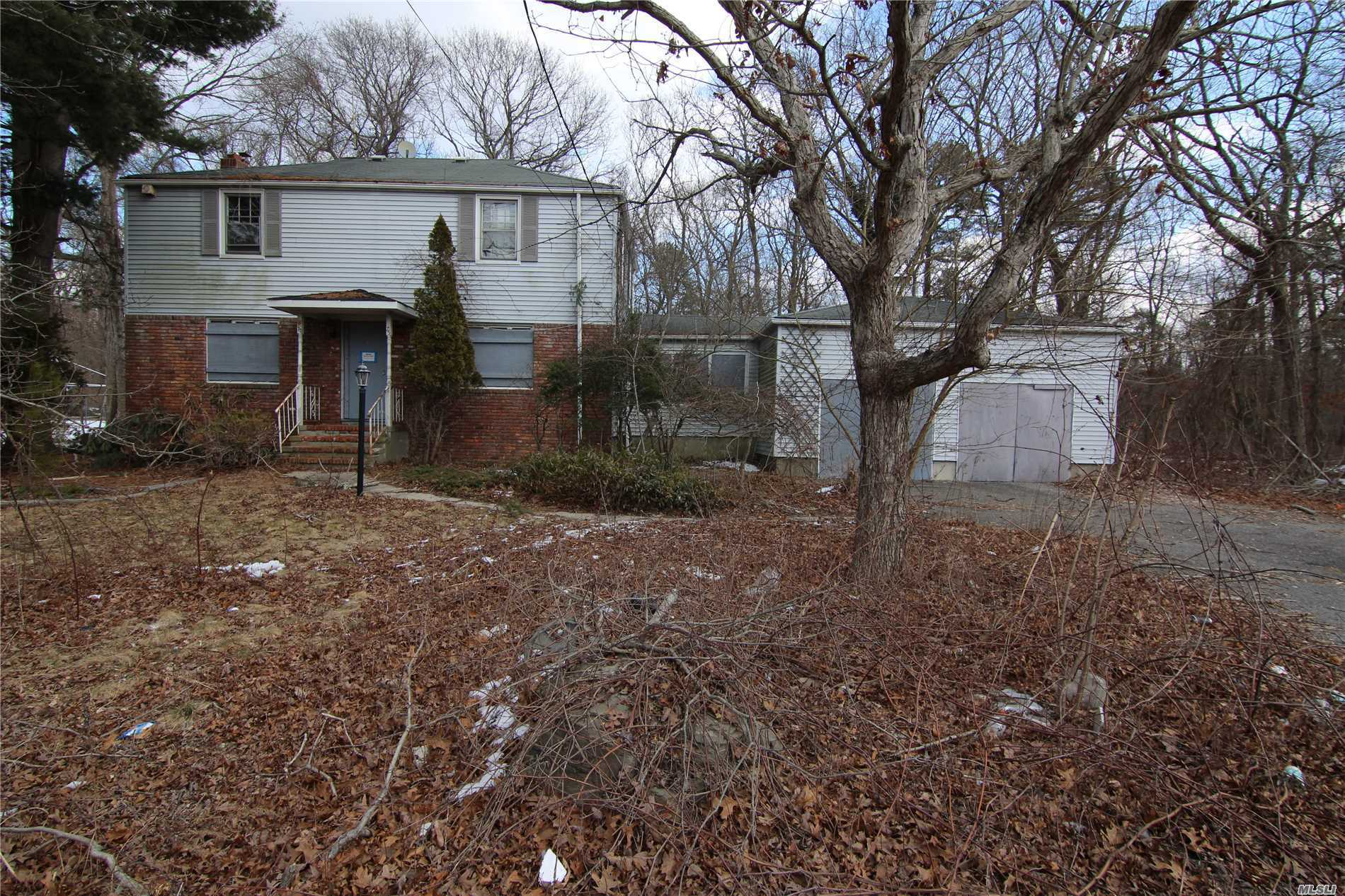 Incredible opportunity large Colonial with 2 car attached garage 3 bedrooms full basement Hardwood floors enormous kitchen with lots of cabinet and counter space. As Is Condition