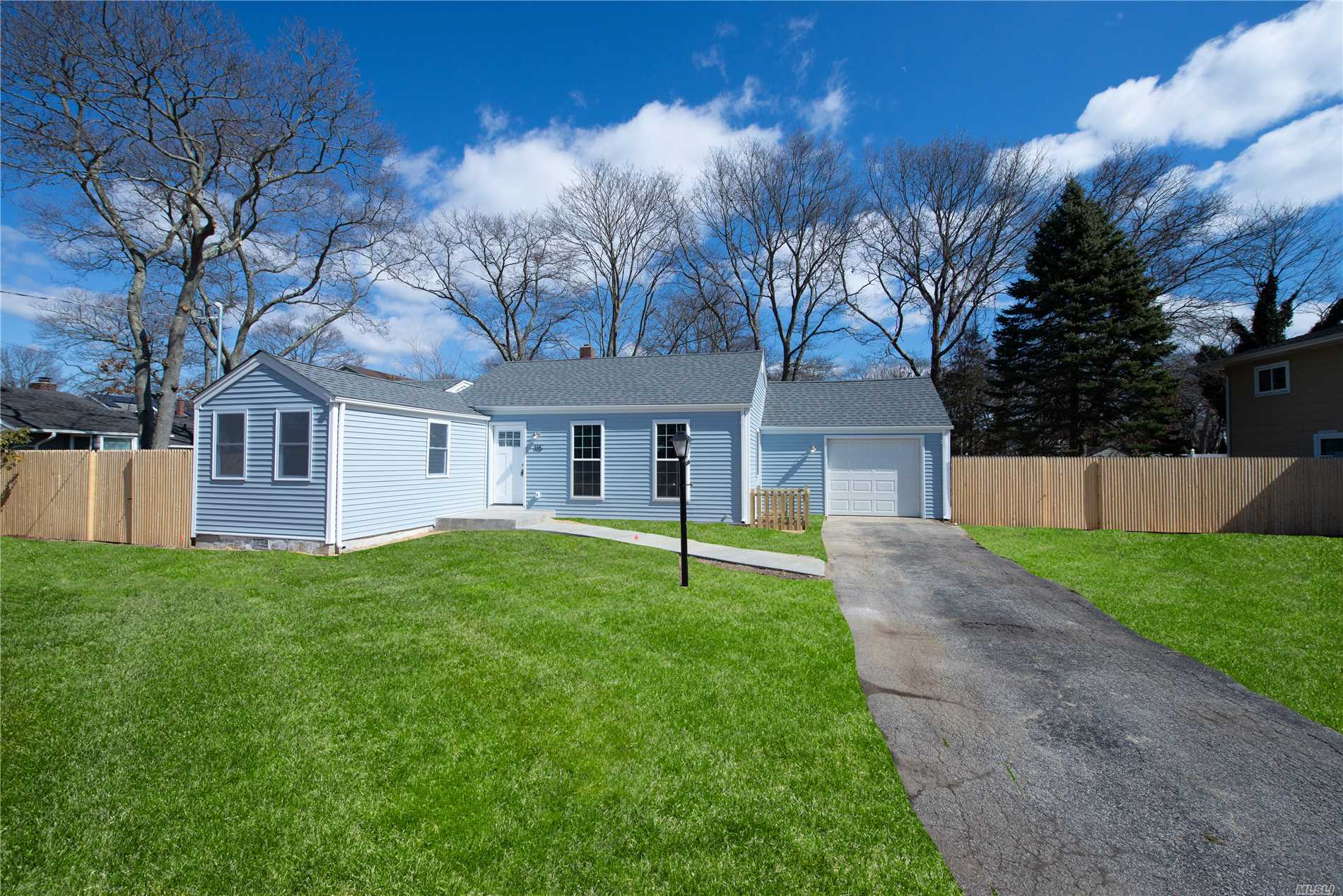 Don't miss this perfect 3br, 2ba, ranch style starter home in Sachem SD. Home features new roof, siding, windows, handscraped floors, white shaker kit, SS appliances, quartz counters, master w/ba, custom tile bath's, an OFP and cathedral ceilings. part finished basement w/egress windows. Builder spared no expense. great backyard with patio, perfect for entertaining. this home will not last!!!