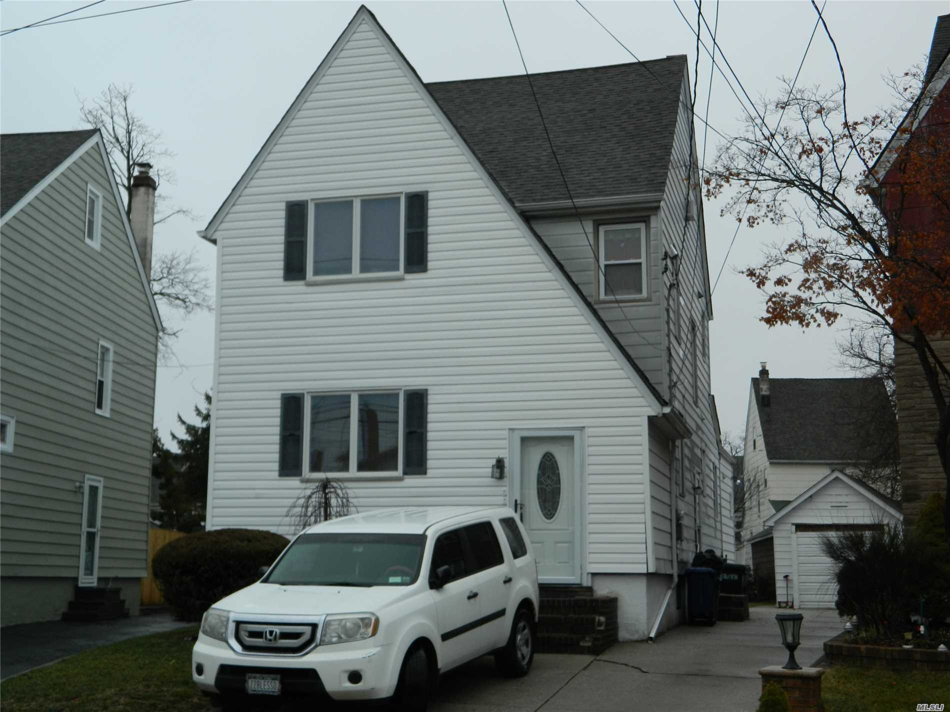 2nd Floor, Living rm/ Dining area, Modern Kitchen w/ Granite Counter tops. Stainless Steel Appliances,  3 Floor 2 Brs. Hardwood Floors Throughout. All Utility's included in, how ever summer few Months pay addition $25 for usage of Air conditions. offer 1 Car parking Only. 1 Block from Gibson LIRR station.