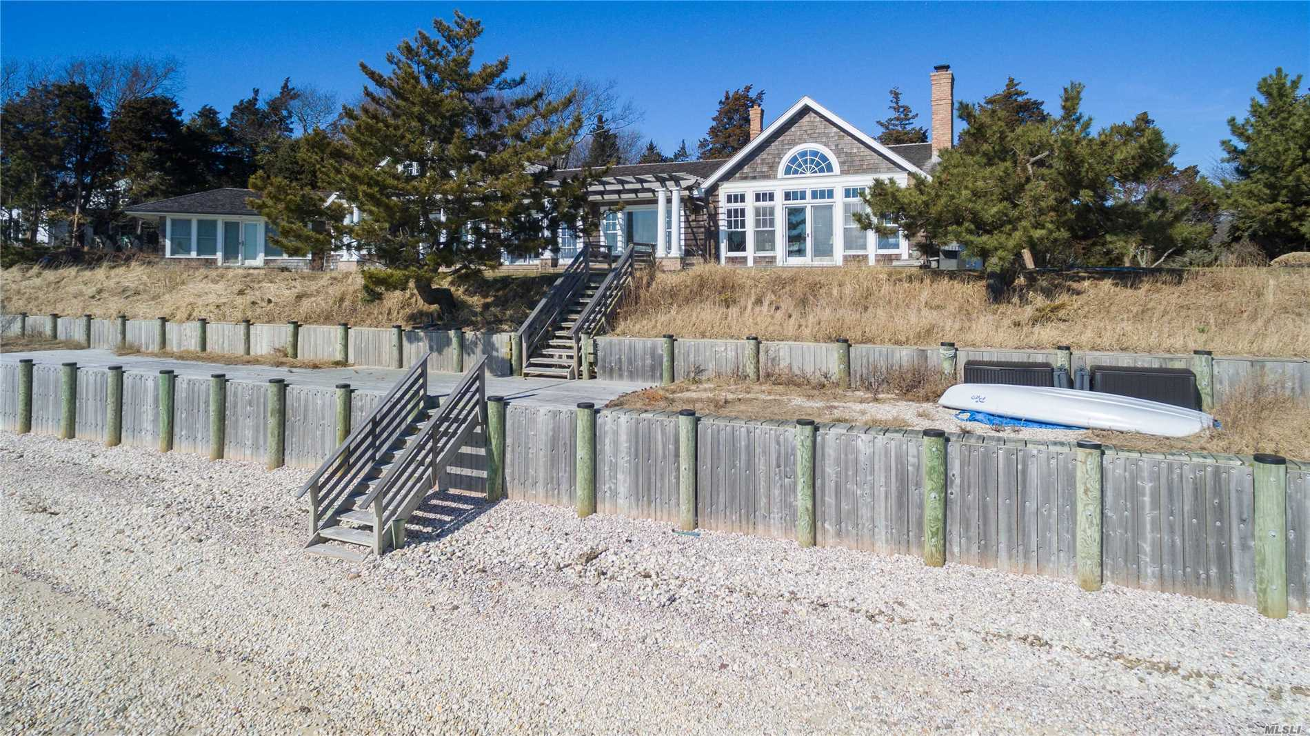 1st Time Offered. Gorgeous Nantucket Style Home. Gut Renovated. 200' Direct Waterfront And Beach With Incredible Views From All Principal Rooms. Slate Patios, Beach Decks And Al Fresco Dining - All With Direct Water Access. Outdoor Shower And Yards Complete The Best In Coastal Living. 5 Bedrooms(King, 3 Queens & 1 Full)