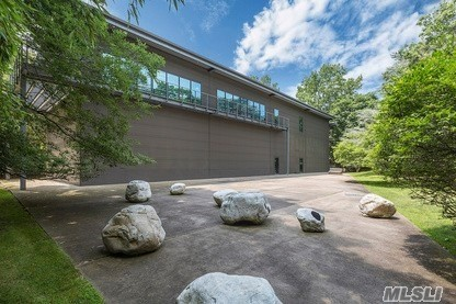 A unique opportunity to own this climate controlled modem 7500 square foot structure with residence zoning, and set on 2.1 acres south of the highway. Moments away from the villages of Westhampton Beach, Quogue and Atlantic Ocean beaches. Soaring heights and south facing walls of glass allow for various uses. A private art collection, art studio, private car collector garage/showroom to name just a few. Just listed separately and smartly priced.