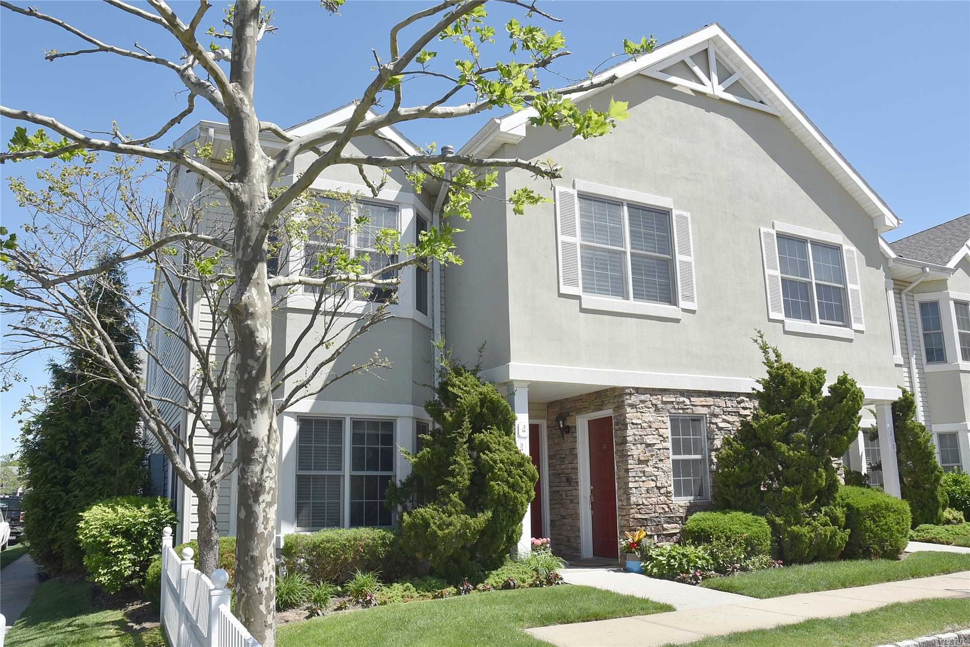 Bright, sun-filled second floor corner unit in beautiful Mill Pond Estates! Two large bedrooms with two baths; large living/dining area with fireplace and hardwood floors. Lovely kitchen; full size washer/dryer and closets galore! Sliders to a private terrace out back. Amazing location minutes from shops, restaurants and the bay. Jitney to to L.I.R.R. Clubhouse with indoor pool; card room; large meeting room; catering kitchen; fitness room; library and more! Over-55 living at its finest!