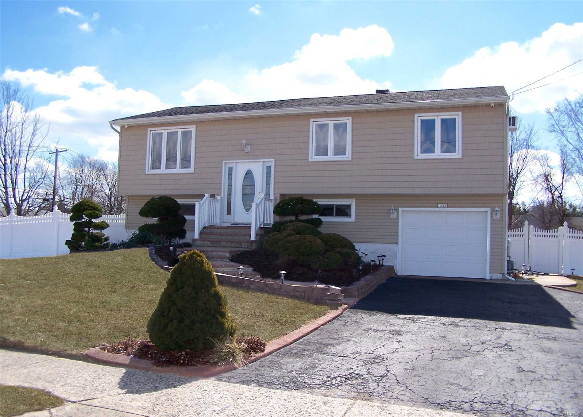 Clean Well Maintained/Updated Hi Ranch Set Up For Accessory Apartment W/Proper Permits. Features 4 Bedrooms, 2 Full Baths, Living Rm/Dining Rm, 2 New Kitchens W/Granite, Updated Bathrooms, New Roof, Siding, Hardwood Floors Throughout, Fenced In Yard W/17X35 Ig Pool W/New Liner. Priced To Sell In Sachem Schools. Shows Easily By Appointment.