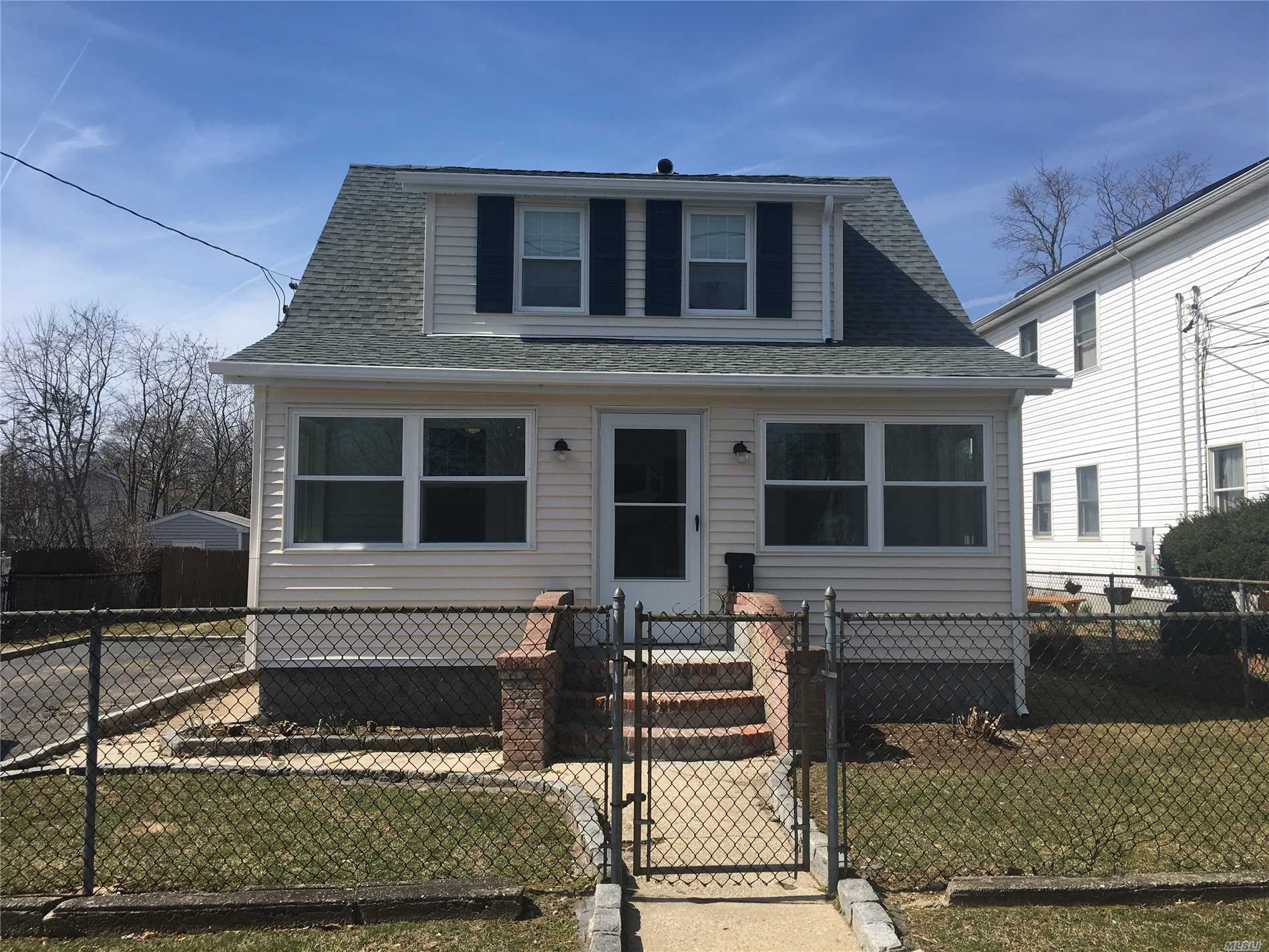 Charming Colonial totally redone. Inviting closed in front porch/New Windows/Roof/Gutters/New floors/doors/highhats/ceiling fans/bathroom/new R13 insulation throughout whole house/new electric panel/Spic and span Just move in and unapck.
