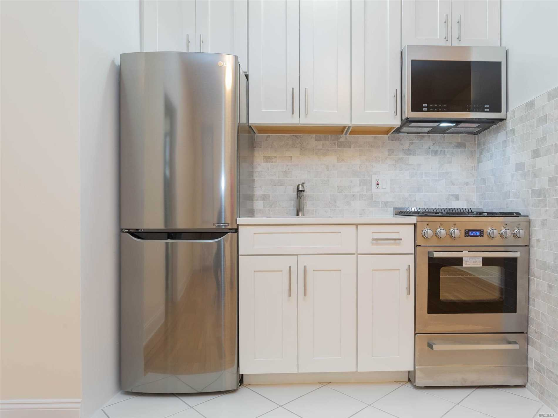 Stunning Junior 1 bedroom unit in Sunnyside NY,  just blocks away from shops, restaurants and the 7 train Subway. Just Minutes to Midtown!! Unit features hardwood floors, ample closet space, stainless steel appliances, quarts counter top and exquisite marble backsplash in the kitchen. Also, Bathroom is totally renovated with marble tile. The building has a laundry room, extra storage for bikes and Sitting Area In The Back. A must see!!