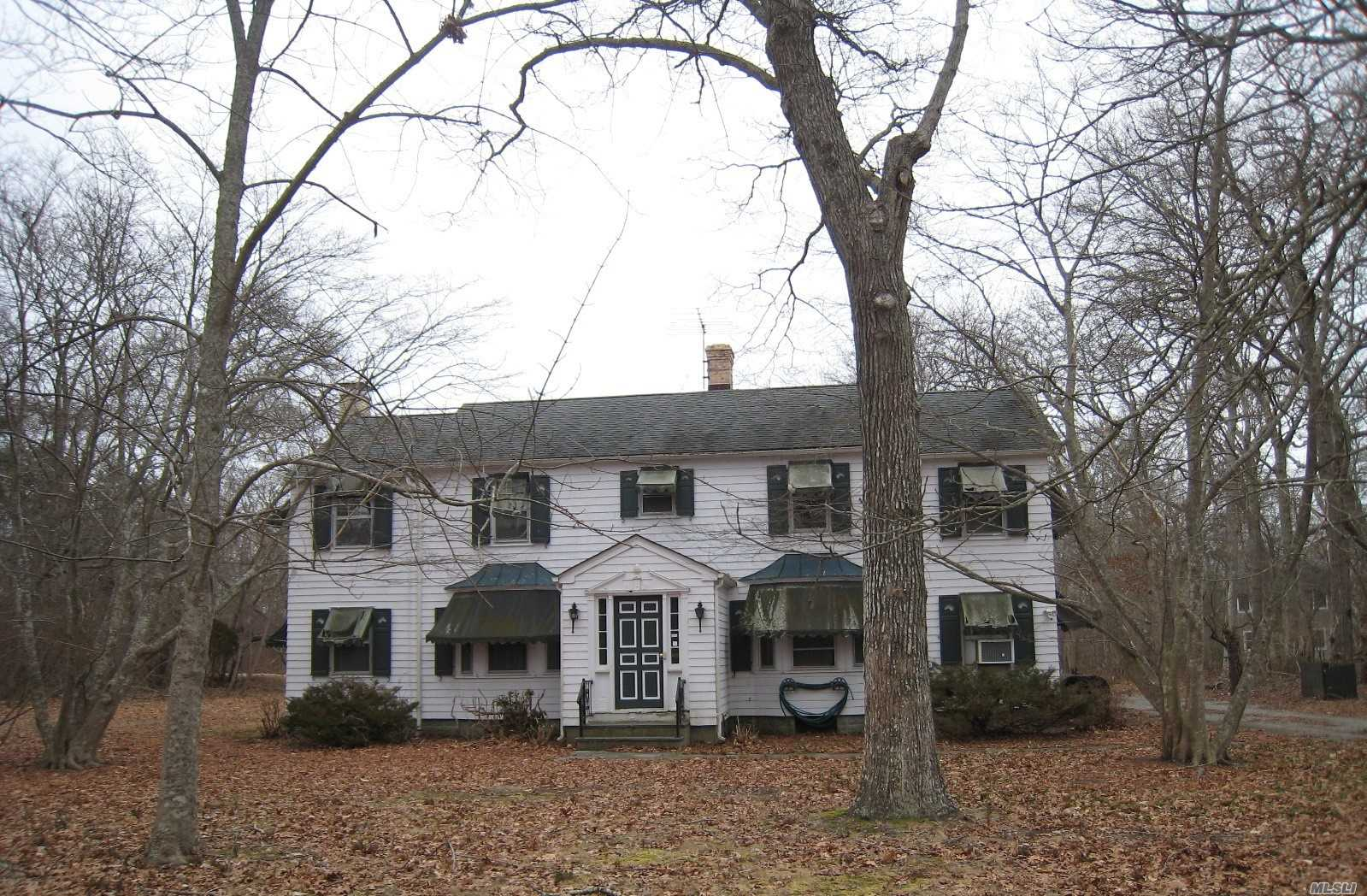 This gracious dowager sits on a large corner piece of property set back from a quiet country road. Detached three car garage also contains former horse barn. Room for a pool and possibly room for tennis.