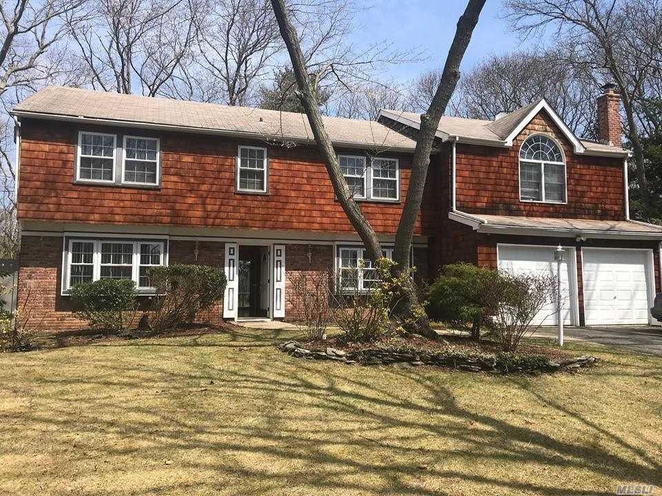 One Of A Kind 4 Bdrm 2.5 Bath Colonial W/ attached 2 car garage Plus Legal 1 Bdrm Accessory Apartment W/ Cathedral Ceilings, Palladium Window & Eik..Legal Detached 4 Car Garage W/ Loft, Electric, Heat & Air (permitted use by co is Storage) 3 Yr Old- 3 Zone Burnham Oil Burner, Lawn Sprinklers, Built in Wall Divider Fish Tank. Three Village SD. An Oasis like Private Property All Minutes From Stony brook Medical Center And College.