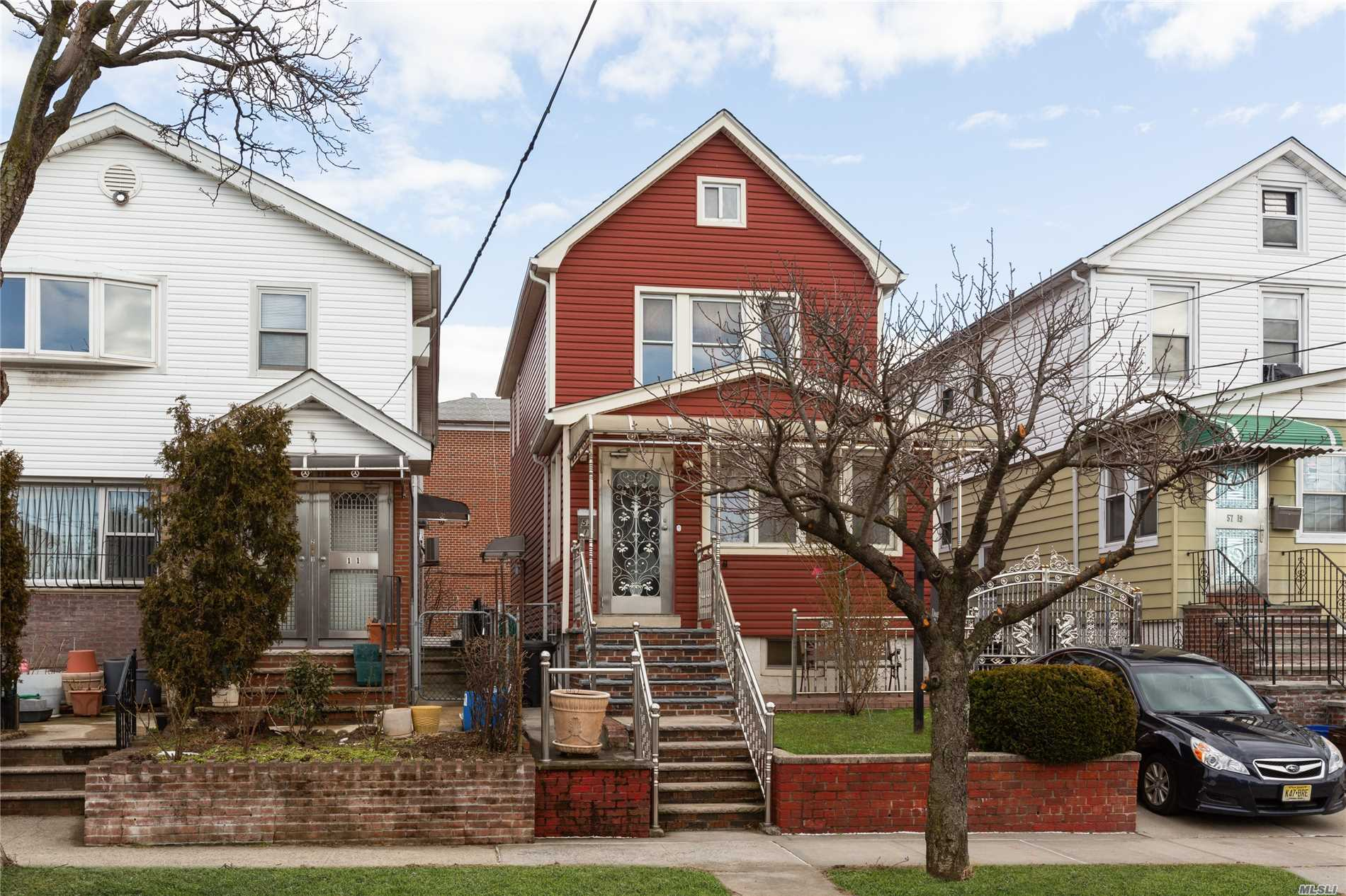 Flushing. The Property Is In Totally Renovated Excellent Condition, Beautiful Stainless Steel Gate And Front Door. Full Finished Basement With Separate Entrance. R4-1 Zoning. Great Location, Close To Everything, Hospital, Buses, Supermarket, Long Island Expressway.