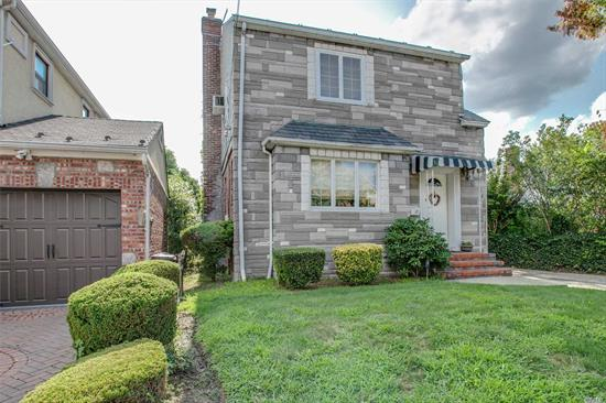 Detached Colonial In Prime Bayside Location. Features Updated Eat-In Kitchen, Den, Living Room And 3 Bedrooms. Vaulted Ceiling In Master Bedroom. 5700 Sqft Lot W/Park-Like Backyard 40x142 Lot. Ps159, Is25, Bayside High School. QM20 Express Bus To Manhattan One Block Away.