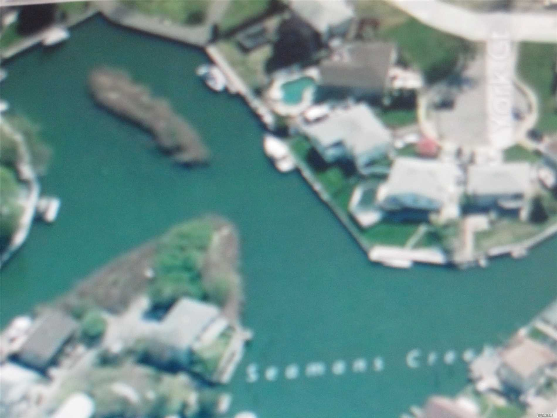 Are You A Builder! Are You A Boater ! Or Just Want To Live On The Water! This Is an Opportunity To Build A New Home On A Unique Cul De Sac Location!! 200 Ft Of Waterfront On 3 Sides Of Property!! Level Land w/Gas And Sewers On Street. Electric On Property. Bulkhead Not Required But A Retaining Wall Is. Included In Sale An Island Adjacent To Property- Take A Look !!