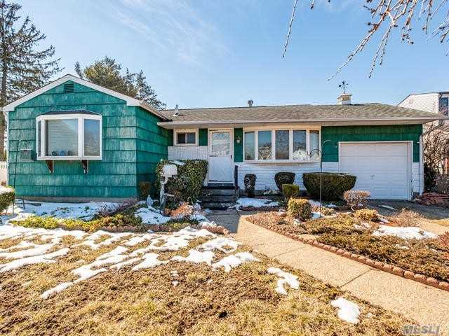 Large Expanded Ranch featuring added master bedroom, plus 3 original bedrooms. Expanded eat in kitchen, living room, fully finished basement with laundry room and workshop. Cedar closets. Plenty of storage. Lovely neighborhood, nestled among Million Dollar + renovated homes. Minutes to LIRR.