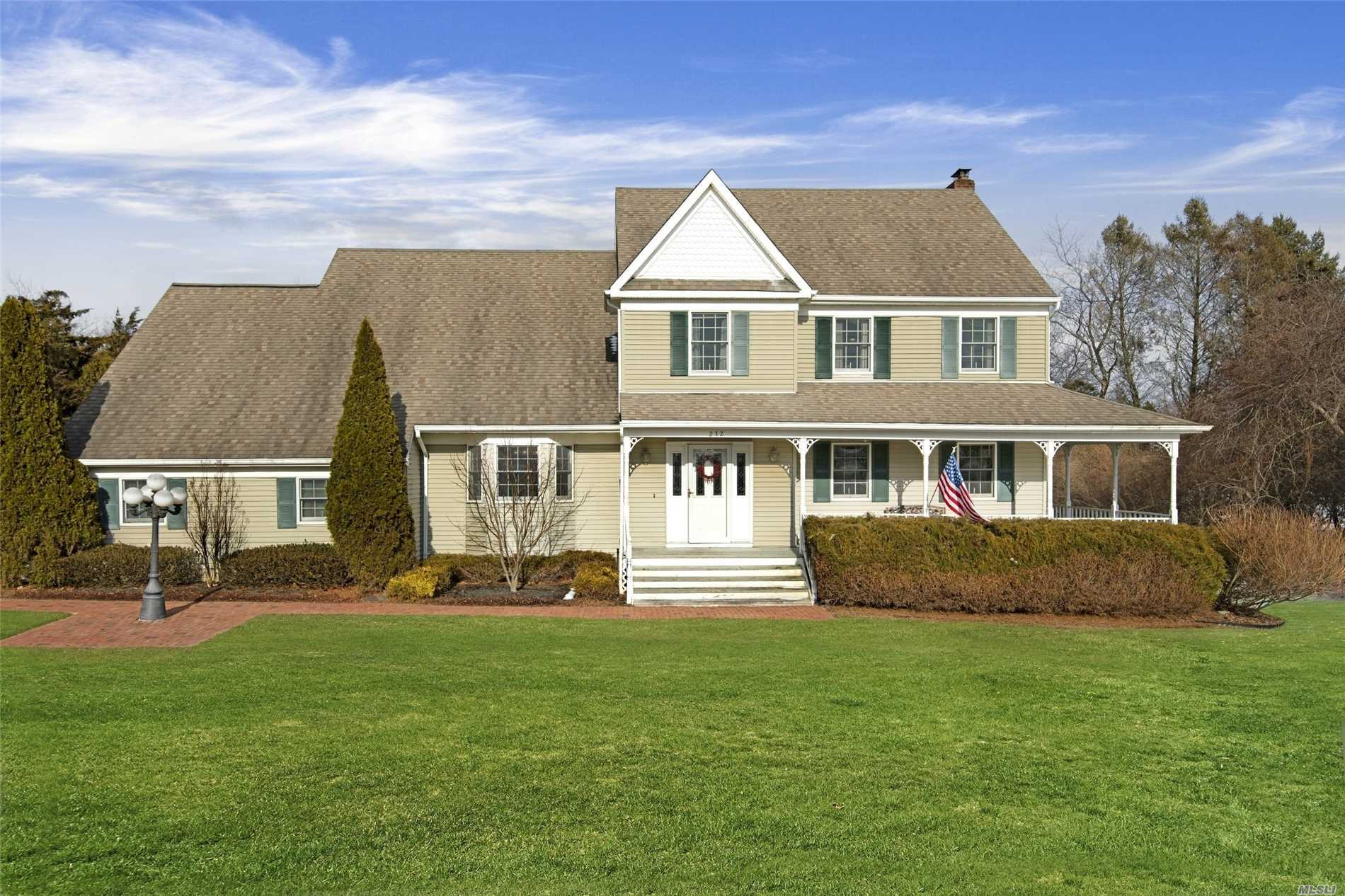 Enjoy North Fork Living From This Traditional, 4 Bedroom, 2.5 Bath Colonial On Over One Acre Of Manicured Grounds With A Wrap-Around Porch, Deck, Heated In-Ground Pool, Custom Kitchen, Wood Burning Fireplace And Hardwood Floors In A Very Quiet Neighborhood. Close to all the North Fork has to Offer!