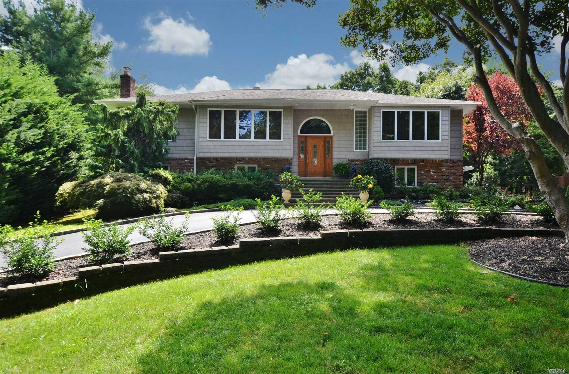 Stunning Curb Appeal Leading To Beautiful 6 Bedroom, 3 Bath spacious home. Situated on Private Acre of Professionally Landscaped & Cared For Property. Hardwood Floors, Gourmet Updated Eiks W/Custom Cabinets and Granite Countertops, Stainless Steel Appliances, Sun-Drenched Family Room W/Sliders Leading To Outdoor Deck Overlooking Country Club Backyard w/Ig Pool And Fabulous Entertaining Spaces. A True Entertainer's Delight!