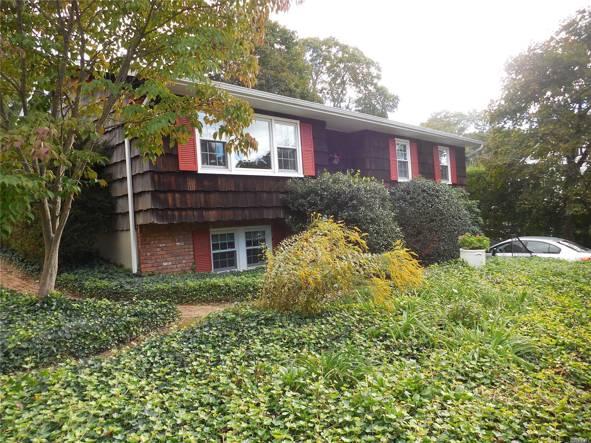 On a quiet street in the heart of Northport Village - this new to the market home boasts winter water views- a 14.5 X 20 newly added Great Room - with a wood burning fireplace- a soaring 16 foot peaked ceiling - and walls of glass opening to a covered deck and expansive brick patio overlooking a very private back yard!! Seconds from Main St and all that it has to offer- restaurants - village dock - gazebo - Engeman Theater and shops.!!Gas on the Street - A MUST SEE HOME !!