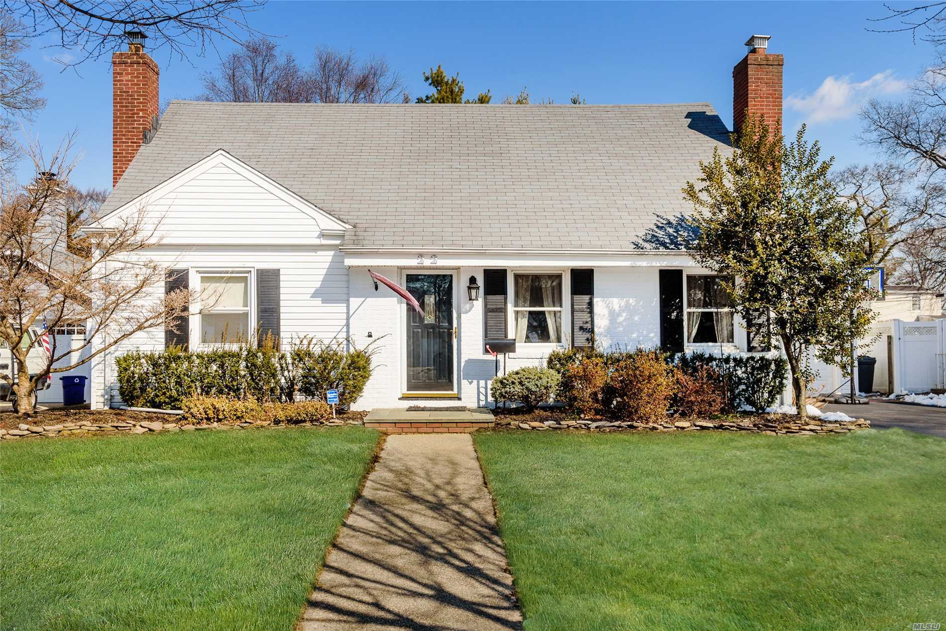 Large Expanded Briarcliff Cape With Many Updates. 2 Fireplaces, 1 Wood Burning, 1 Gas, Huge Custom Eik Overlooking Large Den With Sliders Into Yard With Trex Deck. Hardwood Floors Thru Out, New Washer, Dryer. Updated Windows, 1 Car Garage With Loft For Storage. Surround Sound Inside And Outside. Ductless Ac Unit In Den.