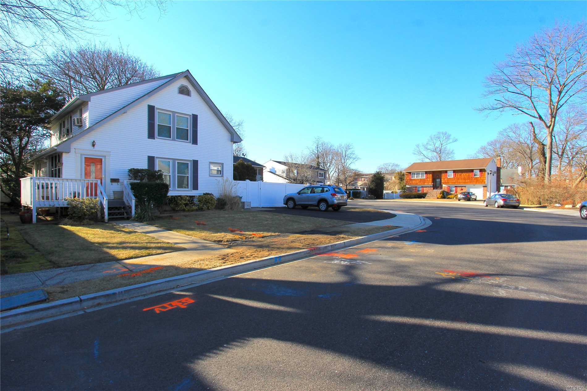 3Br 2Ba Cape Located On A Cul-De-Sac w/ 1st Floor Open Floorplan! Beautiful Eat-In-Kitchen w/ Island & SS Appliances. Large Formal Dining Room. Hardwood Floors Throughout. Full Living Room W/ Wood Burning Fireplace. Usable 1st & 2nd Floor Ductwork for Central Air. Huge PVC Fenced Backyard w/ Paver Patio. Recently Finished Basement w/ New: Flooring, Doors, Moulding & Electric. Merrick Schools: Chatterton Elementary, Merrick Ave Middle, Sanford K. Calhoun High.