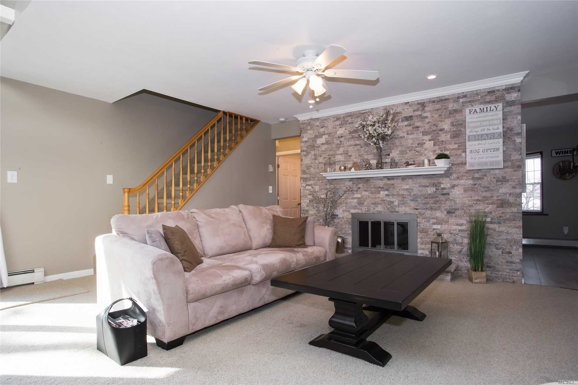 This home is a beautiful Levittown gem. This completely updated mid-block cape is move-in ready!! Updates include new eat-in kitchen, new bathrooms, all new carpeting and stunning stone fireplace. Close to parks and shopping! Make this house your new Home!