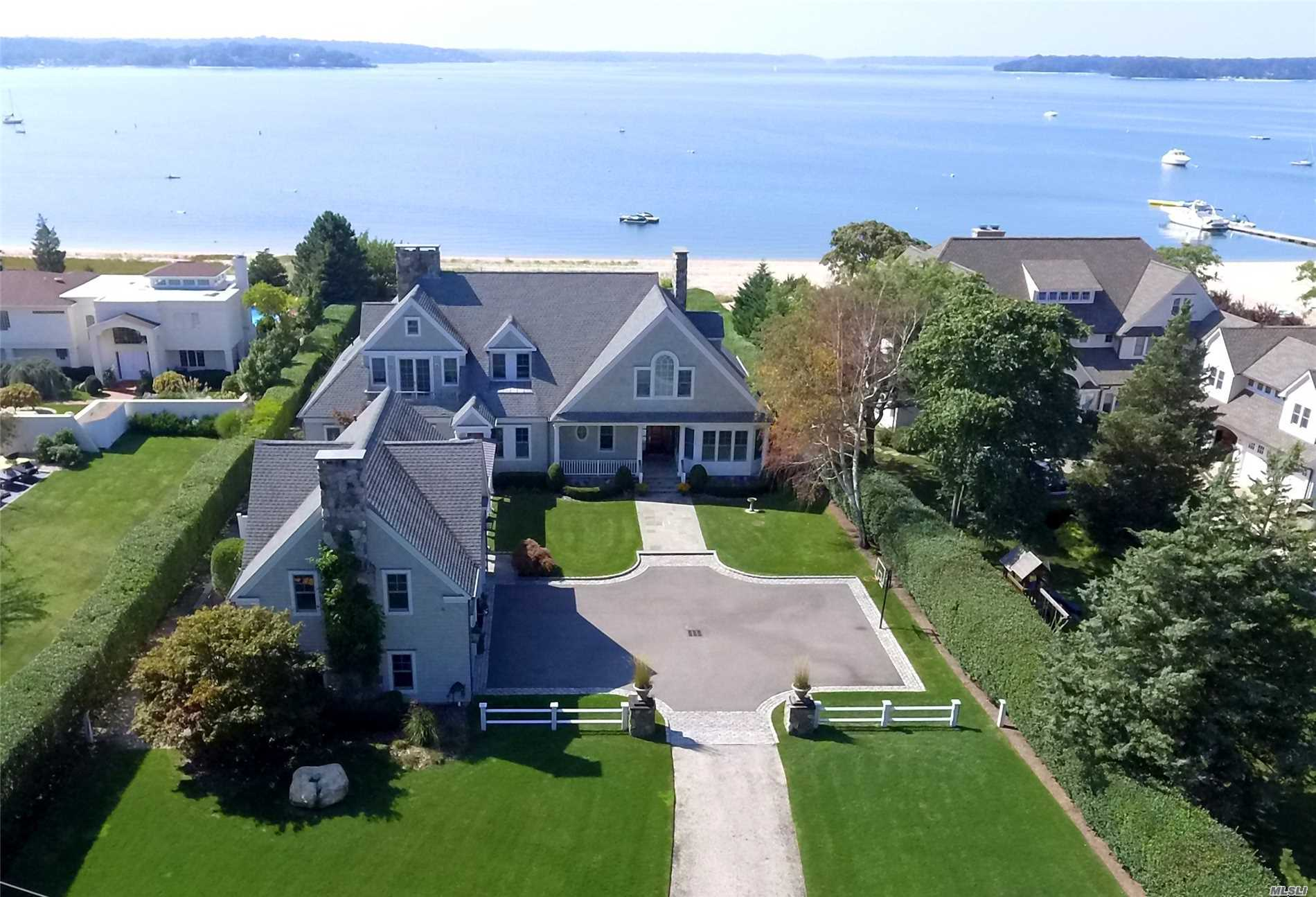 A Rare Waterfront Offering, Beautifully Situated On The Sought After Bay Side Of Asharoken. Custom Built 6300 Sf 2 Story Shingle Style Home W/Heated Ig Pool & Lush Green Lawn Stretching To 100 Feet Of Sandy Beach W/Stunning Views & Western Sunsets. Quality Craftmanship, Exquisite Architectural Details & Custom Finishes Throughout. 10 Ft. 1st Fl. Ceilings & 9 Ft 2nd Fl. Radiant Heated Floors. Spectacular Great Rm W/Fp, Kit & Bth Over 3-Car Garage.Generator.14 Ft Elevation. Private Beach & Mooring