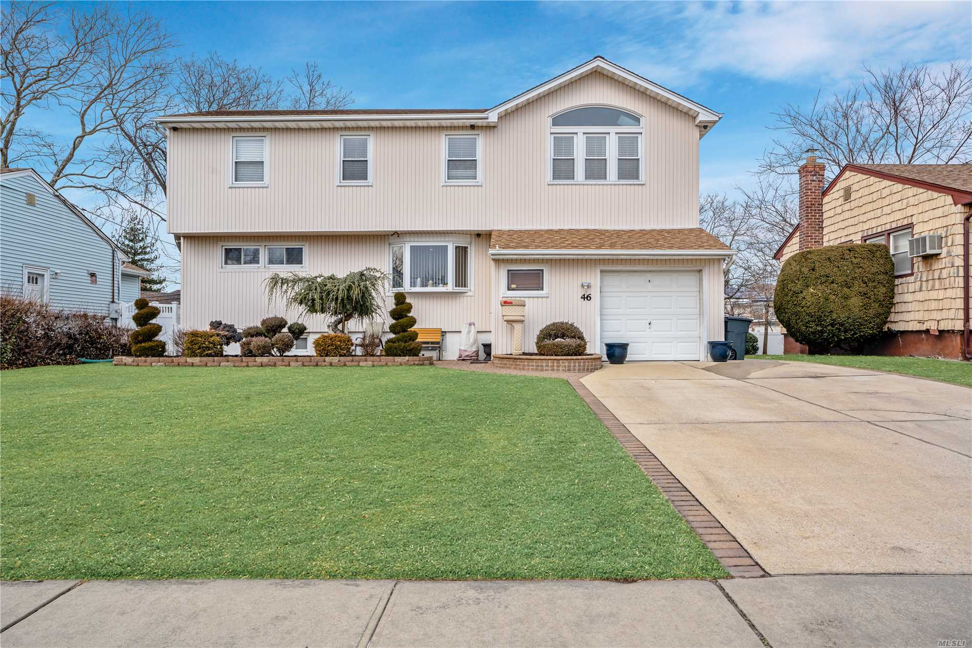 Living is easy in this impressive,  spacious residence with cathedral mother daughter suite. This triple mint stunner has been meticulously maintained and upgraded throughout. Spacious bedrooms, generously-sized living/dining area with stunning family room graced by fireplace and skylights. California closets throughout. Built in sound system, hard wired state-of-the-art security and sprinkler system. Full finished basement with laundry room and pantry. Too many upgrades to name!!!