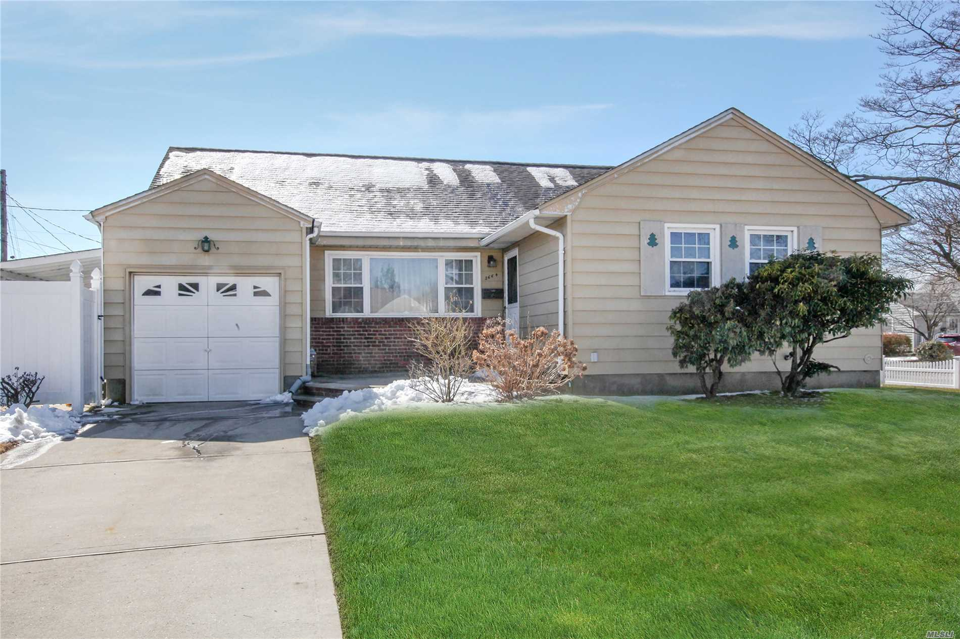 Beautiful and inviting 4 bedroom 2 bath expanded ranch. Lovely wood floors, updated appliances, boiler 1.5 years old, PVC fence. Conveniently located to shopping, highway and railroad station