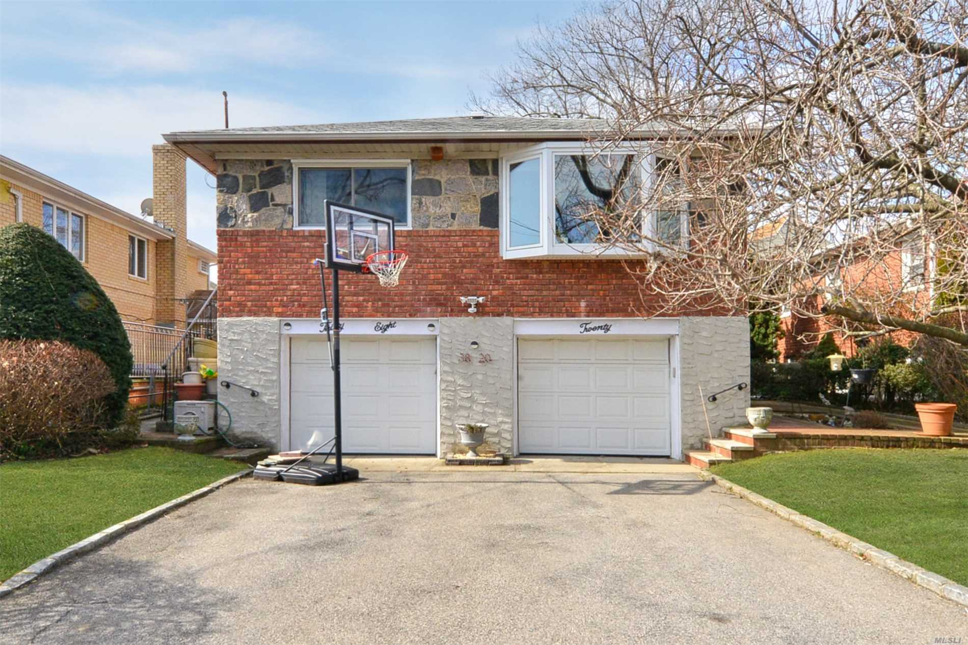 Located On One Of The Prettiest Blocks In Bayside- This Detached, Brick High Ranch Has Been Totally Renovated From Top To Bottom. New Kitchen, Bathrooms, Windows, Roof, Etc. Blocks Away From Lovely Bay Terrace Shopping Center, Bell Blvd, Bayside Lirr, Buses & Easy Access To All Major Highways. Sd 26- P.S. 41, Ms 158,  And Bayside H.S.