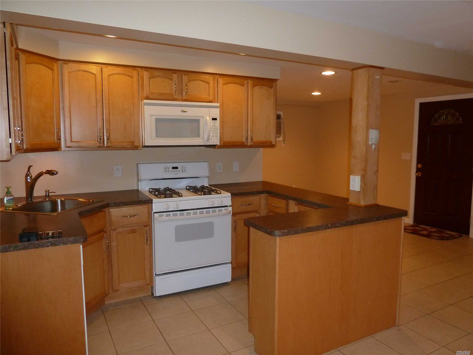 Spacious One Bed Room Apt With Open Concept Living Room, Dining Room, Kitchen With Granite Counter Tops. Large Den/Office With Sliding Doors To Patio And Yard. Tiles Floors Through Out.