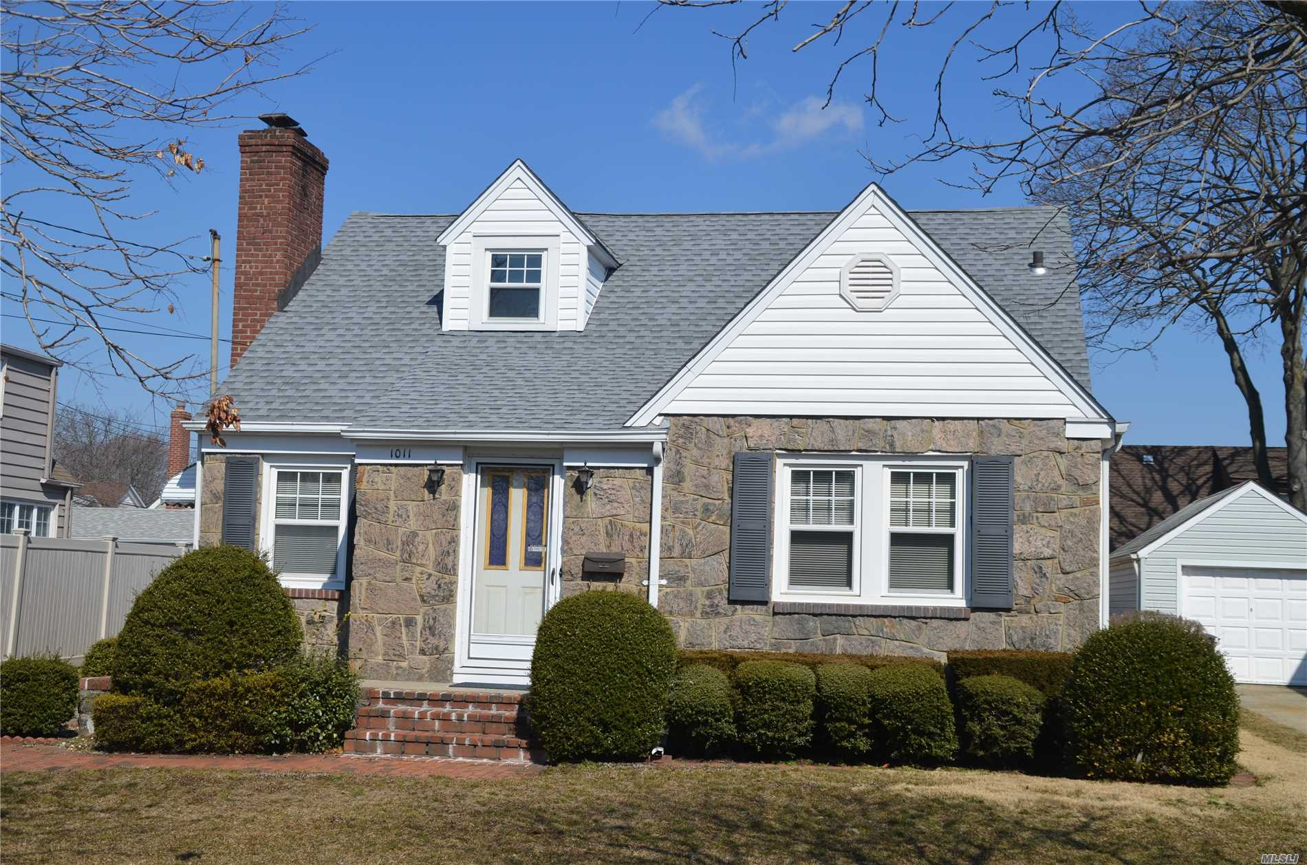 SUPER LOW TAXES!!! Phenomenal retirement or starter home. This cozy 2 bedroom Cape has amazing potential for finishing the walk-up attic into a 3rd bedroom. This home feature wood floors, a wood burning Fireplace, open Eat in Kitchen, and a full finished basement/family room, just blocks to the LIRR and Steele Elementary School.