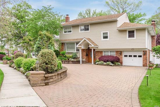 Magnificent one of a kind extended Split boasts 5 Bedrooms + home office, 3 Full Ba, 1 -1/2 Ba, 3 Gas Fireplaces,  - Custom Kitchen w high end SS App, Granite counters, Tile & H/W Floors,  Formal DR flows into LR w/Fireplace, Hugh MB full Bath w/Stal Shower & Sun Deck. Bdrm, Full Bath, Full Finished Basement , Florida Room leads out to magnificent backyard w/outdoor Chef Kitchen, patio w/built in seating & Pond w/ waterfall. Circular Driveway, Garage, CAC and more. A Must See!