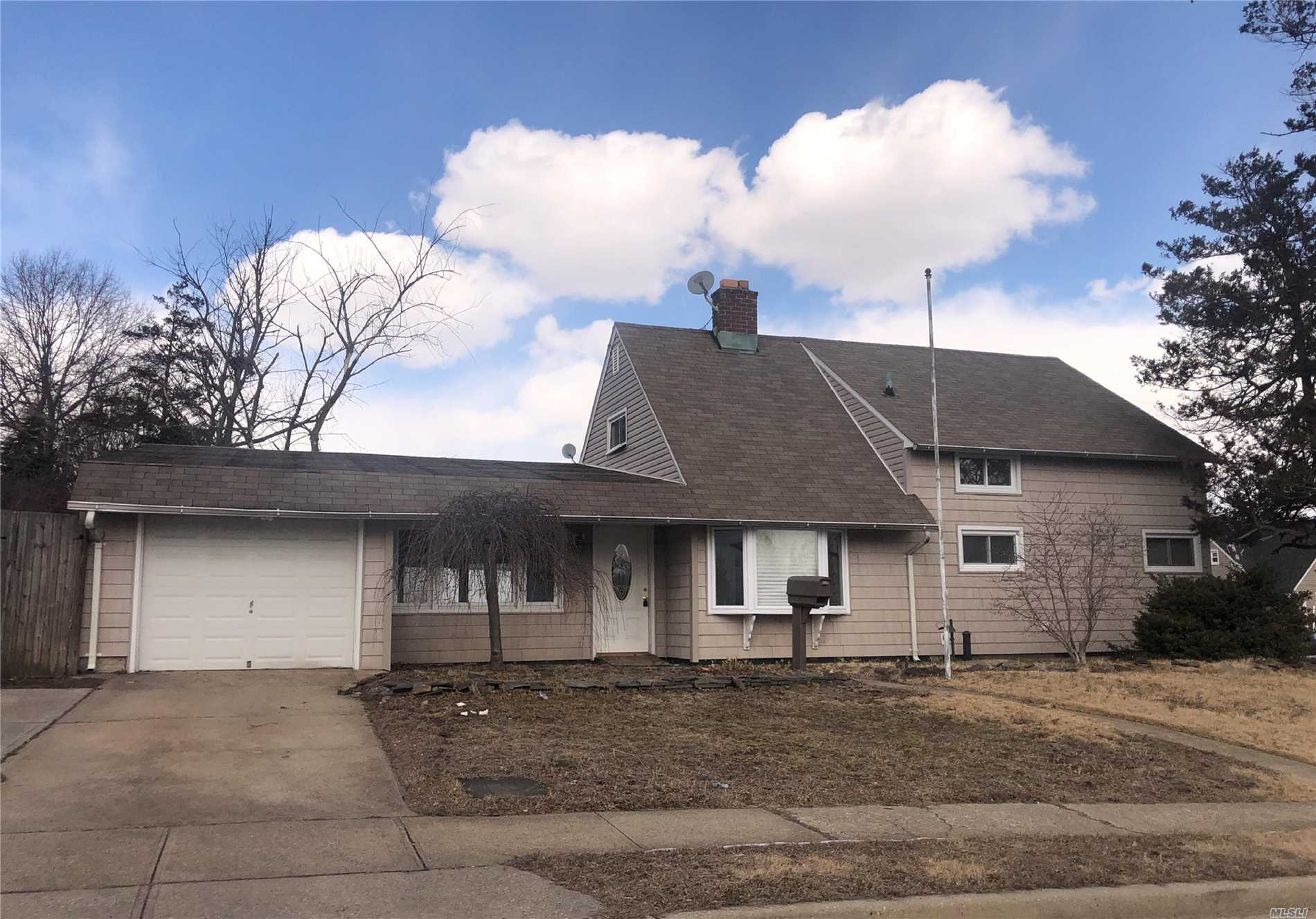 Fantastic expanded ranch located on large, oversized corner lot. Great floor plan, and lots of potential. Attached one car garage.