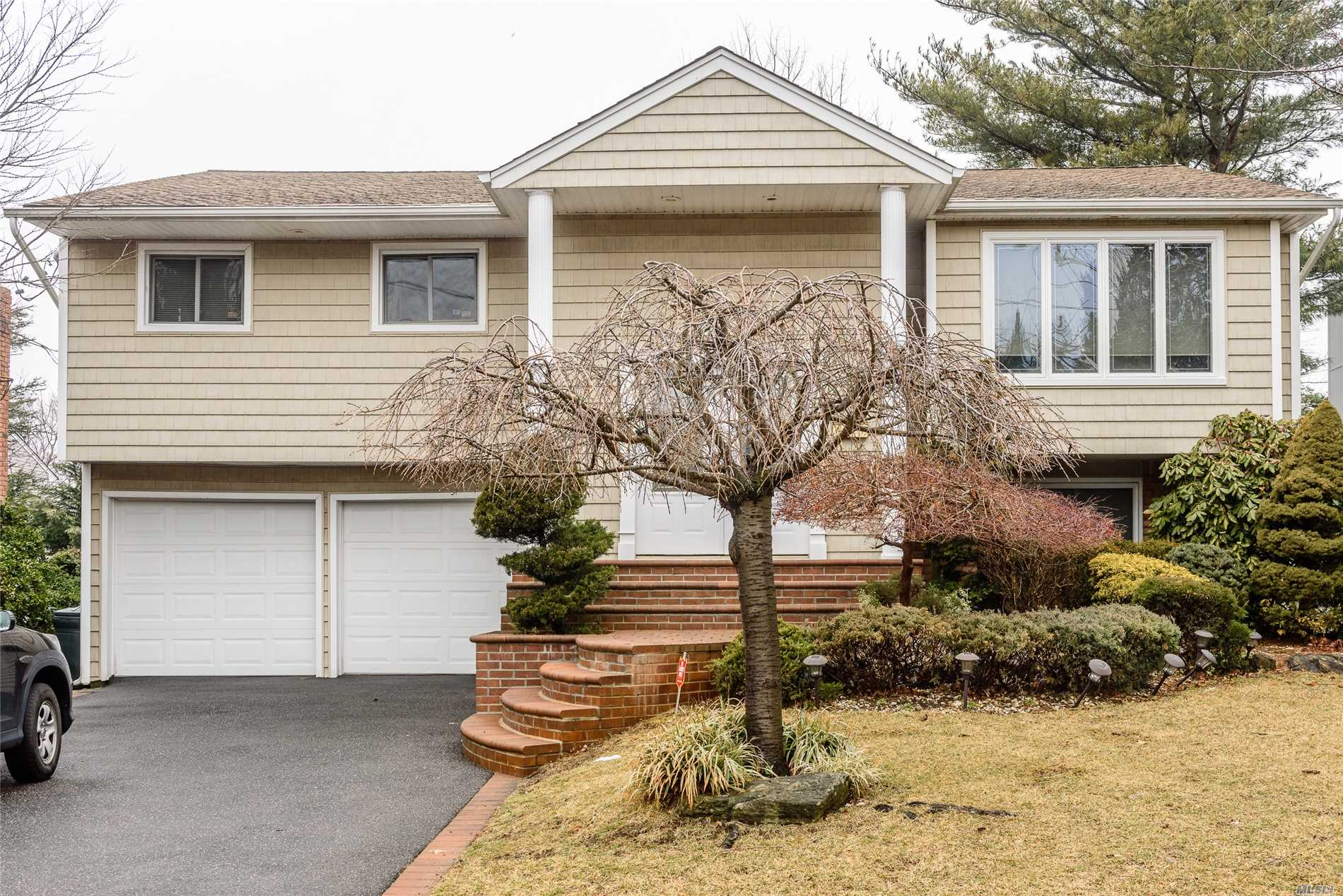 Desirable Bosa Nova Wideline Hi-Ranch--Dual Staircase--Renovated Exterior--Pavers/Sealed Drive/Siding/Large Upper Deck W/Awning --Great Backyard Updated Appliances, Double Entry Door, Oak Bannister, Replaced Roof & Siding, Slomin's Security System To Station, Oil Tank Almost New!, Replacement Windows, Central Air & Boiler Approx. 7 Yrs. New! Spacious & Inviting Home!