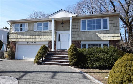 new eik cranite ct, , floors all sanded and stained, new appliances, deck, off dr, , 2 baths re done down all floors new ltv fully painted, down bath new. out side new pavers , new entrance stairs driveway circular good parking Close to town and train 2 miles to Beach