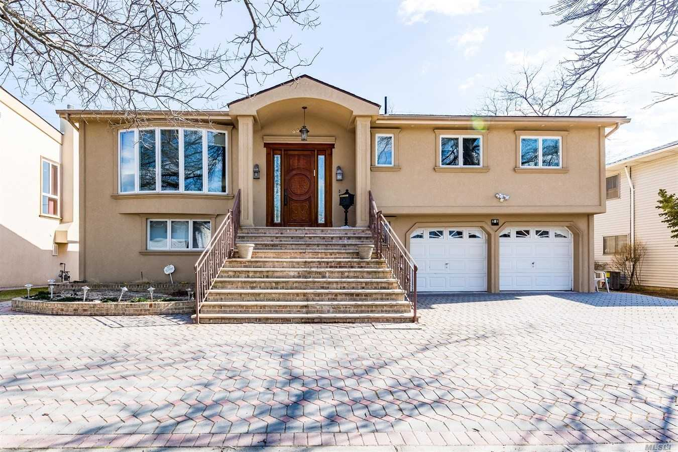 Extraordinary Expanded High Ranch Nestled In North Woodmere. Fully Equipped Rare Beauty Of Excellence & Perfection. Magnificence Designed State Of The Art Kitchen With Top Of The Line Appliances. Stunning Backyard With Waterview & Beautiful Landscaping.